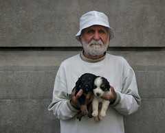 Puppies for free (Dragan*) Tags: street old portrait people urban dog pets white man texture face hat animal wall puppy beard small young oldman greybeard babyanimal