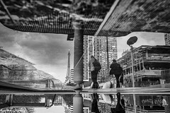 Just an illusion (karmajigme) Tags: travel blackandwhite paris france reflection monochrome nikon noiretblanc eiffeltower toureiffel
