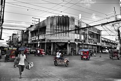 A busy Sunday in Downtown Tacloban - the Philippines (40emem) Tags: life road street old people bw color colour building lumix fire flickr downtown tricycle philippines sunday olympus snap busy trike bnw f25 ep3 leyte tacloban 14mm