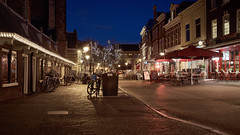 Downtown Haarlem (McQuaide Photography) Tags: street old city longexposure nightphotography winter light urban en holland haarlem netherlands dutch architecture night zeiss outside restaurant licht lowlight europe nacht terrace outdoor availablelight widescreen sony tripod nederland panoramic nightlife fullframe alpha 169 oud terras oude stad steakhouse alberts manfrotto noordholland gebouw c1 straat horeca 1635mm northholland a7ii variotessar captureone mirrorless sonyzeiss mcquaidephotography ilce7m2 captureonepro9 groenmarktwilma
