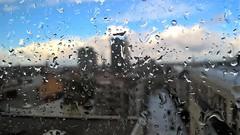 Het weer vandaag heel ambetant (Mado AwaD) Tags: city blue winter sky cloud building wet glass rain weather skyline outdoor dorp