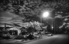 Crying wolf in the neighborhood (PeterThoeny) Tags: california street light sky blackandwhite cloud texture monochrome night streetlight raw cloudy outdoor neighborhood sanfranciscobay hdr scatteredclouds photomatix fav200 1xp nex6 selp1650