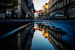 241/365 Spotted (ewitsoe) Tags: city urban woman reflection building cars architecture sunrise 35mm walking puddle mirror streetphotography poland parked pozna chillymorning nikond80 vsco ewitsoe erikwitsoe