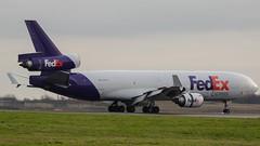 FedEx MD-11F N585FE STN 18/01/16 (robdsn) Tags: fedex md11 stn trijet stanstedairport 3holer