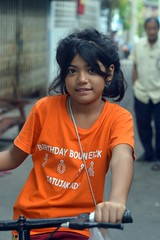 pretty girl on a bicycle (the foreign photographer - ) Tags: orange girl bicycle shirt portraits thailand nikon pretty bangkok bang bua khlong bangkhen d3200