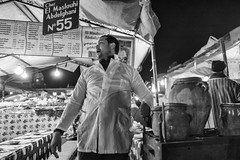 Chez El Maslouhi Abdelghani. (enzo marcantonio) Tags: africa street leica city travel people blackandwhite bw food man night work square outside holidays place outdoor streetphotography eat enzo marocco marrakech souk streetphoto q streetfood summilux ethnicity jamaaelfna marcantonio leicaq enzomarcantonio