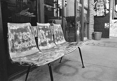 Bench and Bread (Georgie_grrl) Tags: blackandwhite toronto ontario pasteup face bread chairs seat bakery storefront pentaxk1000 benches kensingtonmarket rikenon12828mm ilfordasa400