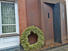 Symbolic wreath at Black Door into former KGB building in central Riga, Latvia. February 12, 2016 (Vadiroma) Tags: city memorial europe capital baltic latvia wreath riga cornerhouse kgb 2016 rga latvija blackdoors
