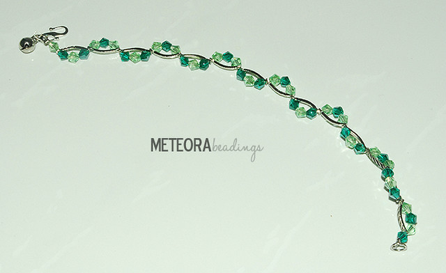 Bracelet - dark and light green beads, with silver seperators