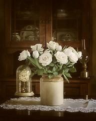 White Roses (vesna1962) Tags: roses stilllife home vintage diningroom vase desaturated cottagestyle vignette tabletop oldfashioned oillamp whiteroses mantelclock welshdresser