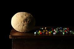 Mistaken Identity of a Maternal Melon (Studio d'Xavier) Tags: stilllife marbles melon mistakenidentity strobist maternalmelon