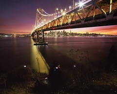 Behind (Under) the Scenes at the Bay Bridge (RZ68) Tags: bridge sunset sky color water skyline night canon buildings island golden bay nikon gate san francisco long exposure with treasure candid working photographers velvia cameras yerba provia buena rz67 e100