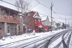 Elvis in an April blizzard, watching for spring (beyondhue) Tags: street old winter white house snow canada storm car spring shot quebec balcony elvis gatineau hull blizzard beyondhue