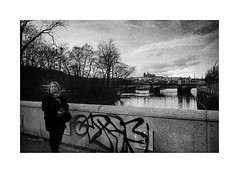 A beautiful city in the ugly day (Jan Dobrovsky) Tags: street city people urban bw castle film contrast analog graffiti prague grain delta 3200 ilford vltava leicam6