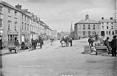 Square, Cahir, Co. Tipperary (National Library of Ireland on The Commons) Tags: fountain carts crates marketsquare thesquare cahir glassnegative countytipperary cotipperary robertfrench williamlawrence nationallibraryofireland lawrencecollection williamirwin limerickbybeachcomber lawrencephotographicstudio thelawrencephotographcollection jfoconnor odwyerscommercialandfamilyhotel