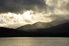 Between Darkness and Light (juliecarmen.fahy) Tags: light sunset shadow newzealand sky cloud sun lake mountains water clouds island darkness dusk south nz rays te anau fiordland shadowland
