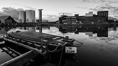 Everything Must Go (McQuaide Photography) Tags: light blackandwhite bw cloud holland reflection building water netherlands monochrome dutch skyline architecture zeiss photoshop outside boot mono licht boat canal blackwhite still lowlight europe factory village forsale waterfront outdoor widescreen sony tripod nederland wolken peaceful wideangle panoramic calm adobe fullframe alpha 169 tranquil waterside fabriek dorp manfrotto noordholland gebouw ringvaart gracht lightroom waterscape wolk wideanglelens halfweg oldfactory zwanenburg tekoop 1635mm suikerfabriek northholland a7ii groothoek variotessar mirrorless sugarcity sonyzeiss haarlemmerliedeenspaarnwoude mcquaidephotography ilce7m2