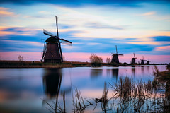 Kinderdjik at dusk (adrianchandler.com) Tags: longexposure sunset sky holland water netherlands windmill beautiful dutch reeds landscape canal amazing colorful exterior outdoor dusk five famous windmills landmark row calm historic unescoworldheritagesite serene bluehour nederlands waterway kinderdjik adrianchandler canon5dsr