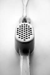 B&W 3 (chloejadeyoung) Tags: camera white black art kitchen composition contrast canon project photography design photoshoot personal object space experiment holes research concept dots crush utensil perforation