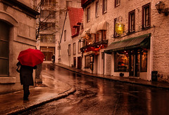 almost dark (JimfromCanada) Tags: street old red woman reflection heritage wet girl rain shop umbrella wow dark evening alone afternoon shine quebec walk brilliant