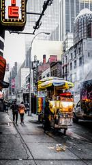 Between The Cracks (Gordon McCallum) Tags: nyc newyork sony streetscene foodcart bwwithcolor sigmaartlens sonya6000