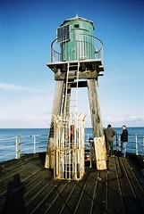 (Fellhunter) Tags: ocean travel sea water 35mm photography pier fishermen harbour olympus whitby analogue om developed 35mmphotography filmphotography travelphotography whitbypier analoguephotography photographersoftumblr originalphotographers