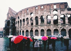 Rain and ruins. Rome is very much a place where life is lived out of doors, but that doesnt mean the city isnt a victim to bad weather. Rain in Rome? All you need is to stay positive... (lisavetta2) Tags: italy rome rain landscape ruins colorful coliseum travelphoto staypositive