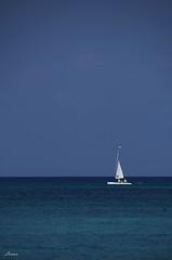 Sail on (lamnn92) Tags: ocean travel blue sky water boat pentax turquoise sail grandcayman sevenmilebeach k50 18270mm