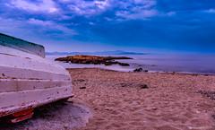 Sandy Beach (Christos Kourmouzoglou) Tags: sea seascape beach clouds boat sand rocks sandy seashore