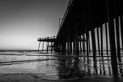 Pismo Beach Pier (AndreasGarcia) Tags: ocean california blackandwhite bw beach water monochrome digital landscape photography pier centralcoast pismobeach originalphotography canon5dmkii