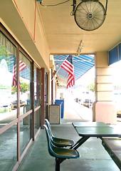 A Great Place to Meet (Art&Music*Woo-Hoo) Tags: fan texas place flag porch verandah meet shortys picnictable breezeway texarkana picmonkey26nov2015