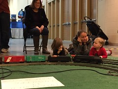"Grandma Miller, Inde, Paul, and Mommy Watch the Trains • <a style=""font-size:0.8em;"" href=""http://www.flickr.com/photos/109120354@N07/24198011673/"" target=""_blank"">View on Flickr</a>"