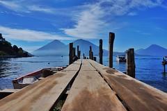 Lake Atitln Dock, Guatemala ((Jessica)) Tags: lake water boats lago dock guatemala perspective atitln volcanoes volcn leadinglines lakeatitln sanantoniopalop volcsno