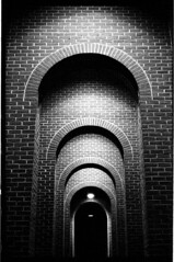 ©  2016 Johnny Martyr  CourthouseSummaritDowntown6400_006_edited-1 Frederick Maryland Film Photographer (Johnny Martyr) Tags: arches arch archway architecture concentric shadows light bw blackandwhite brick nesting darkness night nighttime frederickmd frederickcourthouse court foreboding walkway path leica leitz ilford kodak ilforddelta3200 6400iso availablelight existinglight lowangle leitzsummarit15 5cm15summarit film 35mm symmetry repetition pattern stockphotograph stockphotography stockimage allrightsreserved copyrightprotectedlicenseforsaleusagerightsfilmphotographyfilmphotographjohnnymartyrpublishpublicationmagazinearticlefeaturefeaturedartfineartavailablelightexistinglightnoflashmarylandmdfrederick mdfrederick maryland art artist wwwjohnnymartyrcom design photographersstillusingfilm photographerstillusesfilm photographerusingfilm johnnymartyr marylandphotographer frederickmarylandphotographer 21stcenturyfilmphotography believeinfilm filmisnotdead frederickmarylandfilmphotographer frederickmarylandphotography marylandphotography filmphotographer filmphotography