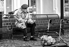 ...and think of all the stories that we could have told (Mister G.C.) Tags: life street old city people urban blackandwhite bw man male monochrome hat germany bench lens deutschland photography prime nikon europe sitting shot image cigarette candid seat streetphotography 85mm smoking photograph elderly nikkor dslr unposed schwarzweiss oldage niedersachsen lowersaxony 18g strassenfotografie d5300 strassenphotographie mistergc