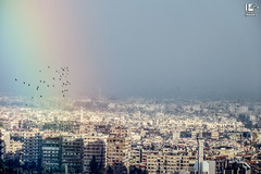 One day they will reach that rainbow, Damascus (Take a look on Syria without propaganda) Tags: world city winter sky home rain army hope freedom rainbow war flickr control free battle victory arab revolution area syria government damascus generation syrian assad dimashqi