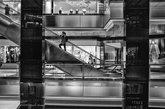 A Modern Shopper on the Ascent (CVerwaal) Tags: nyc blackandwhite architecture ricohgr timewarnercenter