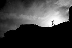 You shall not pass! (creyala) Tags: sky people blackandwhite sun silhouette rock contrast scotland blackwhite friend day ben top hill peak gandalf stick tolkien rinnes
