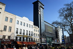 Cinema with a huge tower in central London (Tony Worrall Foto) Tags: county city uk greatbritain england people cinema building london tower english film architecture square stream tour open place candid south leicester country capital watch visit location tourist southern area leicestersquare tall southeast update odeon attraction gather cowd