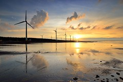 Sunset at Kaomei Wetland  (Vincent_Ting) Tags: sunset sea sky reflection beach water windmill silhouette clouds seaside jetty taiwan  formosa   windturbine crepuscularrays wetland               colorfulbeach vincentting