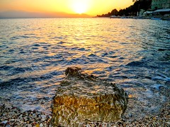 Rock vs the sunset. (Christos Andreou) Tags: photoshop photography mediterranean photographer ngc relaxing greece serenity meditation melancholy naturalbeauty goldensunset seaview beachwalking loutraki beautifulsunset corinthia beautifulworld sealandscape seasunset swimminganddiving seaandsand hdrphotos sunsetswimming greeksun corinthiangulf spectacularphotos wavessunset holidaysingreece greekcoastline nearbythesea oldloutraki samsunggalaxykzoomsamples voltastoloutraki opticalzoomphotos