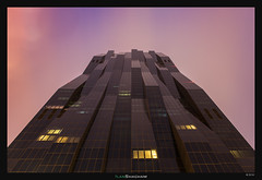 The Dark Tower Reigns (Ilan Shacham) Tags: vienna wien windows light red sky abstract tower architecture modern purple geometry menacing fineart form shape fineartphotography perrault dominiqueperrault dctower