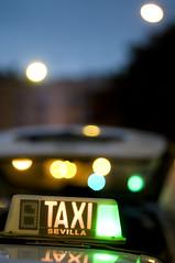 Taxi (ale arillo) Tags: light color slr luz lights luces sevilla andaluca nikon dof bokeh cab taxi free 85mm colores seville desenfoque andalusia libre profundidaddecampo d300
