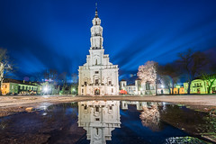 Town hall of Kaunas, Lithuania (A. Aleksandraviius) Tags: old city travel blue white reflection building tower history clock tourism water beautiful stone architecture night dark puddle evening town hall spring big europe european view traditional country culture style landmark tourist baltic medieval historic architect editorial destination historical tall tradition lithuania lithuanian attraction kaunas lietuva 2016 triggertrap