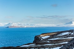 Hrisey Eyjafjordur Iceland (Einar Schioth) Tags: sea sky cliff cloud snow ice nature sunshine clouds canon landscape coast photo iceland spring day outdoor ngc picture shore sland eyjafjordur nationalgeographic hrisey einarschioth