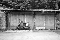 abandoned moped? (howard-f) Tags: old urban blackandwhite bw film analog 35mm taiwan gone urbanexploration taipei analogue filmcamera demolished analogphotography urbanplanning   nikon35ti filmphotography  oldneighborhood filmisnotdead  abandonedneighborhood   demoed
