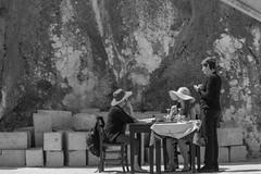 Ordering (kurjuz) Tags: sun restaurant rocks outdoor hats malta ordering gozo xlendi