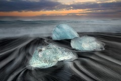 Pearls (TXA Photography) Tags: travel winter sunset sky seascape ice beach clouds contrast canon landscape iceland europe scenic fourseasons canon5d streaks vatnajokull jkulsrln diamondbeach icescape vatnajokullnationalpark canon5dmkiii icelandphototours