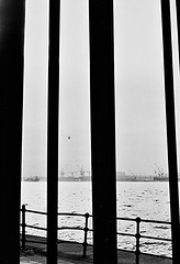 Birkrnhead Through Pier Head (brightondj - getting the most from a cheap compact) Tags: silhouette liverpool liverpooldocks river scan birkenhead scanned pentaxmesuper mersey pierhead rivermersey