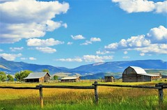 Wyoming Countryside (Patricia Henschen) Tags: ranch mountains clouds barn rural fence countryside fields wyoming grandtetons roadside tetons grandtetonnationalpark mormonrow